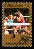 Cuba shows Boxers fighting, series devoted to the Montreal Games 1976, circa 1976. MOSCOW, RUSSIA - JUNE 26, 2017: A stamp printed in Cuba shows Boxers fighting Royalty Free Stock Image