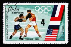 Boxing, Olympic games in Mexico, circa 1968. MOSCOW, RUSSIA - JUNE 26, 2017: A stamp printed in Cuba shows boxing, Olympic games in Mexico, circa 1968 Stock Photography