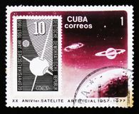 Cuba postage stamp shows satellite in space, 20th years anniversary of space research, circa 1977 Stock Photography