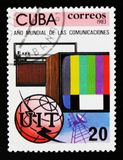 Cuba postage stamp shows TV set, radio, globe and emblem, Year of comunication, circa 1983. MOSCOW, RUSSIA - JUNE 26, 2017: A stamp printed in Cuba shows TV set Royalty Free Stock Photography