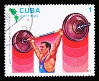 Cuba shows Weigh lifter, 9th Pan American games, circa 1983. MOSCOW, RUSSIA - JUNE 26, 2017: A stamp printed in Cuba shows Weigh lifter, 9th Pan American games Stock Image