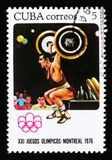 Cuba postage stamp shows Weight lifting, series devoted to the Montreal Games 1976, circa 1976 Stock Photos