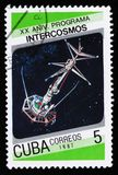 Cuba postage stamp from the `20th anniversary of Intercosmos program` issue shows space satellite, circa 1987 stock photo