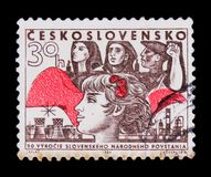 MOSCOW, RUSSIA - JUNE 20, 2017: A stamp printed in Czechoslovakia shows woman with flower, 30 anniversary of rebels, circa 1964 royalty free stock photos