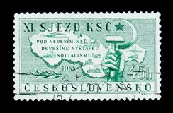MOSCOW, RUSSIA - JUNE 20, 2017: A stamp printed in Czechoslovakia shows map, hammer and sickle, circa 1958 royalty free stock photo