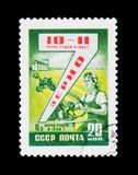 Wheat production and shows plesant woman in combine machine, circa 1958. MOSCOW, RUSSIA - JUNE 26, 2017: A stamp printed in USSR Russia devoted to wheat Stock Image
