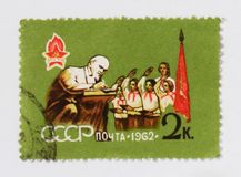 V. Lenin and pioneers, circa 1962. MOSCOW, RUSSIA - JUNE 26, 2017: A stamp printed in USSR Russia shows V. Lenin and pioneers, circa 1962 Royalty Free Stock Image