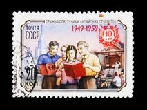 Soviet and Chinese Students, friendship, 10th anniversary, circa 1959. MOSCOW, RUSSIA - JUNE 26, 2017: A stamp printed in USSR Russia shows Soviet and Chinese stock photos
