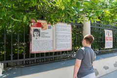 Moscow, Russia - June 02.2016. Teen boy reading a fragment of children's book of war on Myasnitskaya Street Royalty Free Stock Photography