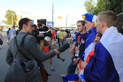MOSCOW, RUSSIA - June 26, 2018: television interviews from French fans after the World Cup Group C game between France and Denmark stock photo