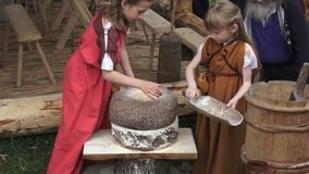 Times and Epochs festival in Kolomenskoe in Moscow, Russia. Reenactment Ancient Rus epoch. Experimental grinding and stock video