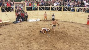 Times and Epochs festival in Kolomenskoe in Moscow, Russia. Reenactment of the Rome empire epoch. Gladiators fighting stock footage