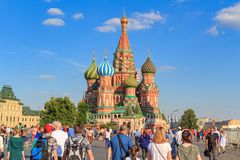 Moscow, Russia - June 28, 2018: Tourists on a background of St. Basil`s Cathedral on Red square in sunny summer evening Stock Photography