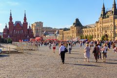 Moscow, Russia - June 28, 2018: Tourists walking on Red square on a background of State Historical Museum and GUM Department store Stock Image