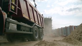 Moscow, Russia - June, 2018: Truck in action on a construction site. Scene. Truck at the construction site stock video footage