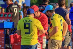 Moscow, Russia - June 28, 2018: Two fans of Colombian football team are next to the mobile tray with soft drinks stock photo