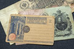 Moscow. Russia. 30 june 2019. Two Russian old banknotes of the early 20th century and a clean postcard of the same time.  stock photography