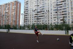 Moscow, Russia. June 5, 2015: volleyball game in the yard. Guy in the jump royalty free stock photography