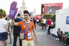 MOSCOW, RUSSIA - JUNE 2018: Volunteer of the World Cup on the fan festevale in Moscow high five royalty free stock photography