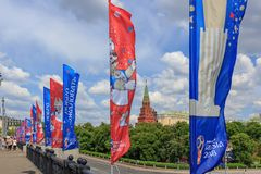 Moscow, Russia - June 03, 2018: Waving flags with symbols of FIFA World Cup Russia 2018 on Bol`shoy Kamennyy bridge on a backgroun. D of Moscow Kremlin tower stock photography