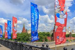 Moscow, Russia - June 03, 2018: Waving flags with symbols of FIFA World Cup Russia 2018 on Bol`shoy Kamennyy bridge on a Moscow Kr. Emlin background stock photo