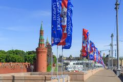 Moscow, Russia - June 03, 2018: Waving flags with symbols of FIFA World Cup Russia 2018 on Bol`shoy Moskvoretskiy bridge on a Mosc. Ow Kremlin background against royalty free stock photo