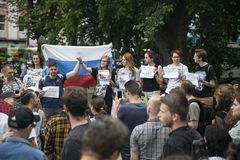 Young people are holding posters in protest against police brutality. Moscow, RUSSIA - June 12, 2019: Young people are holding posters in protest against police stock photos