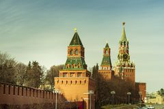 Moscow / Russia - 04.2019: Kremlin wall and towers in Moscow against the blue sky stock images