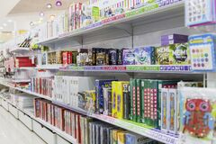 Moscow, Russia, 06/18/2020: A large selection of board games for children on the shelves in a bookstore. Educational toys and