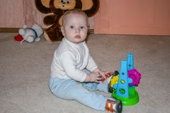 A little boy playing toys. Child at home. royalty free stock photography