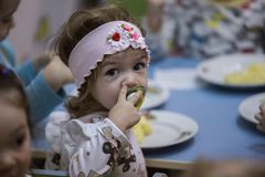 2019.01.22, Moscow, Russia. Little girl have dinner. royalty free stock photos