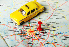 Moscow , Russia map taxi. Close up of Moscow , Russia map and taxi toy royalty free stock images
