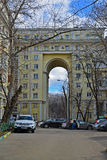 Moscow, Russia - March 14, 2016. Apartment building with an arch on  street Zemlyanoy wall - sample Stalinist architecture. Moscow, Russia - March 14, 2016 Royalty Free Stock Photography