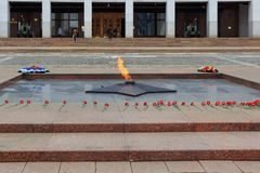 Moscow, Russia - March 22, 2018: Burning Eternal flame with red flowers in Victory Park on Poklonnaya Hill Royalty Free Stock Photo