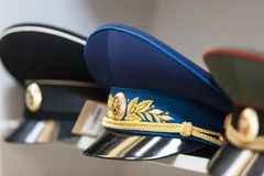 MOSCOW, RUSSIA - MARCH 20, 2018: A cap of a senior commander with a cockade on the shelf. Of a specialized warehouse-store for police and military uniforms, as Royalty Free Stock Image