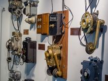 Collection of old obsolete telephones exhibits in the museum. MOSCOW, RUSSIA - MARCH 20, 2018: Collection of old obsolete telephones exhibits in the museum of Royalty Free Stock Images