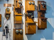 Collection of old obsolete telephones exhibits in the museum. MOSCOW, RUSSIA - MARCH 20, 2018: Collection of old obsolete telephones exhibits in the museum of Royalty Free Stock Photo