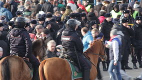 Moscow;Russia-March-eighteenth-Two thousand seventeen year-  flow of fans and mounted police before the football match between pop. Moscow;Russia-March stock video footage