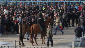 Moscow;Russia-March-eighteenth-Two thousand seventeen year-  flow of fans and mounted police before the football match between pop. Moscow;Russia-March stock video