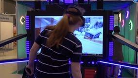 Girl playing skiing simulator video arcade game. Moscow, Russia - March, 2017: Girl playing skiing simulator video arcade game stock video