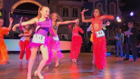 Girls wearing colourful dresses take part in dance competitions. Moscow - Russia, March 10, 2018: Girls wearing colourful dresses take part in dance competitions stock footage