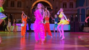 Girls wearing colourful dresses take part in dance competitions. Moscow - Russia, March 10, 2018: Girls wearing colourful dresses take part in dance competitions stock video