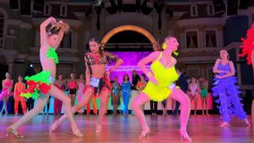 Girls wearing colourful dresses take part in dance competitions. Moscow - Russia, March 10, 2018: Girls wearing colourful dresses take part in dance competitions stock video footage