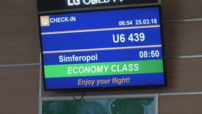 LED display with flight information at the airport stock video