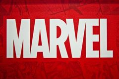 Marvel logo sign printed on banner. Marvel Comics Group is a publisher of American comic books and related media