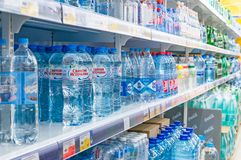 Moscow, Russia - March 12, 2018: Mineral and pure water bottle`s display on the shelf in supermarket.  Stock Photography