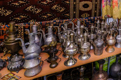 Moscow, Russia - March 19, 2017: Old traditional oriental brass vases and jugs at the bazaar Royalty Free Stock Photo