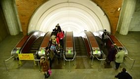Moscow, Russia - March 5. 2016. People are riding on the escalator  at Biblioteka imeni Lenina metro station. Moscow, Russia - March 5. 2016.  People are riding stock video