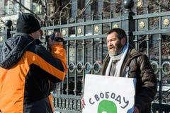 Political prisoner Sergei Mokhnatkin being interviewed on picket Royalty Free Stock Photo