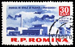 Glass and Ceramics Factory (Sighisoara), Socialism construction in R.P.R. serie, circa 1963. MOSCOW, RUSSIA - MARCH 23, 2019: Postage stamp printed in Romania stock photography